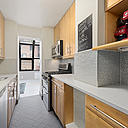 A stylish and renovated three bedroom and three bathroom condominium with home office in the heart of historic Murray Hill. This desirable and rare combined corner unit features an expansive living space with a wall of windows to the South and West with views of the Empire State Building. The separate dining solarium boasts floor to ceiling windows that expand overhead providing the feeling of an outdoor space. There is a wonderful setback terrace accessible from the living room and the master bedroom. The kitchen features granite countertops, stainless steel appliances, and custom cabinetry proving ample store throughout.