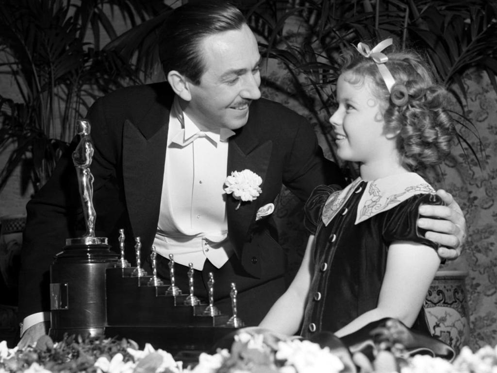 Walt Disney receiving the Oscar for Snow White