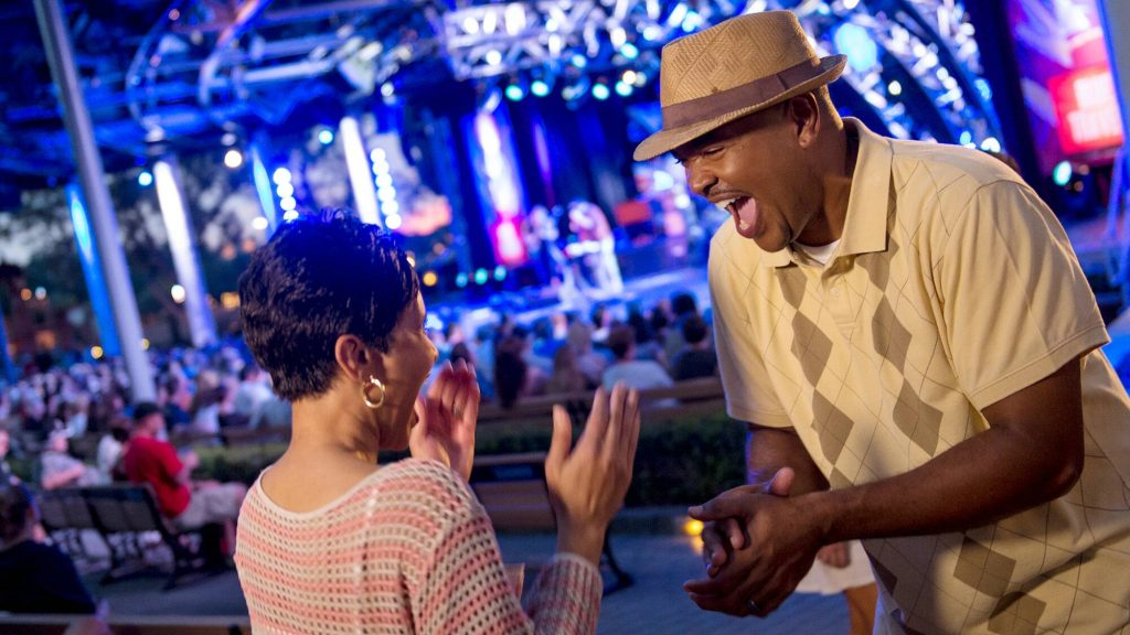 A couple having fun at Epcot's Eat to the Beat