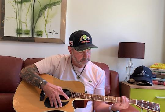 Carl playing guitar