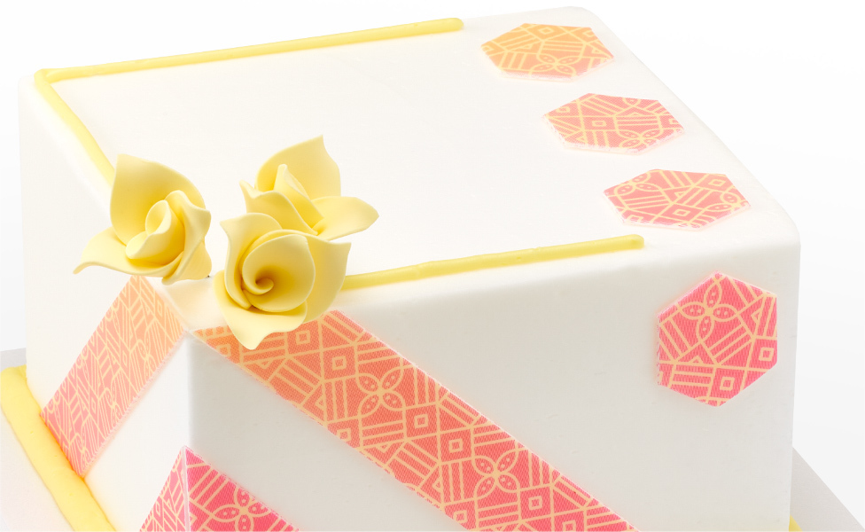 White Cake with Yellow Roses and Patterns