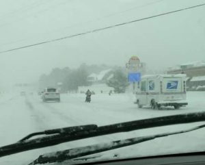 scooter in snow, rehoboth beach, dewey beach, route 1, delaware, susex county, snowshizzle, storm helena 2017