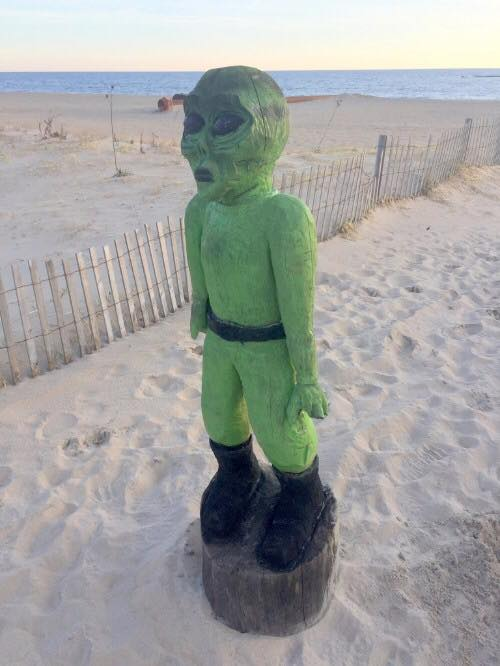 alien statue, dewey beach, delaware, sussex county, beach combing, nor'easter,