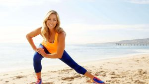 Denise Austin working out on the beach