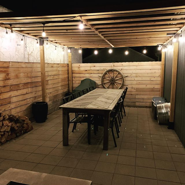 Pandemic Project Trifecta. Finished our pergola, built a potting bench, and made a side table/roof for the wood stack.