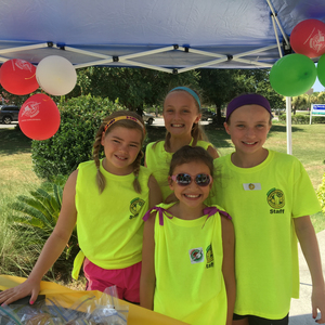 Four girls at lemonade stand