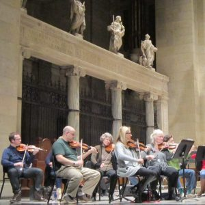orchestra with statues of saints