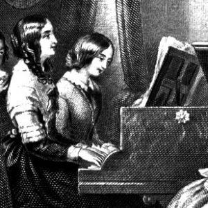 girls playing piano duet