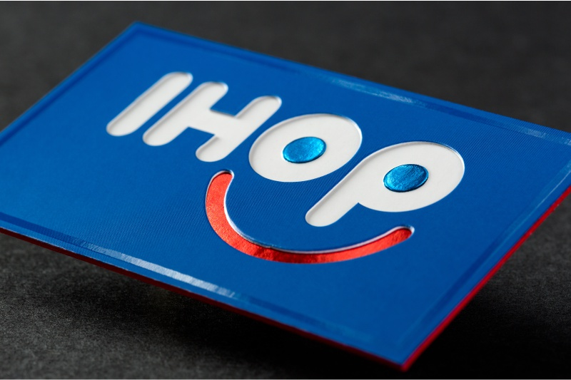 Die cut business cards give shape to your first impression ultra thick silk business cards with custom die cut embossing blue red foils spot uv and red colored edges colourmoves