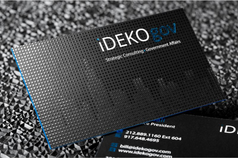 Embossed business cards raise the stakes with embossed silkcards thick silk business cards with spot uv embossing and blue colored edges colourmoves