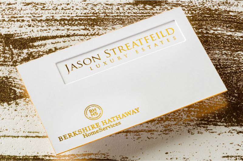 thick suede business card with die cut gold foil and gold colored edges