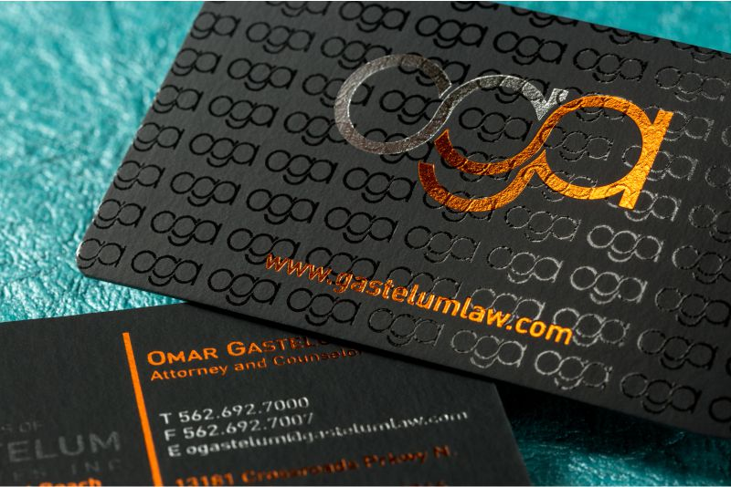 Spot uv business cards make your brand more eye catching onyx suede business cards with orange silver foils and spot uv colourmoves