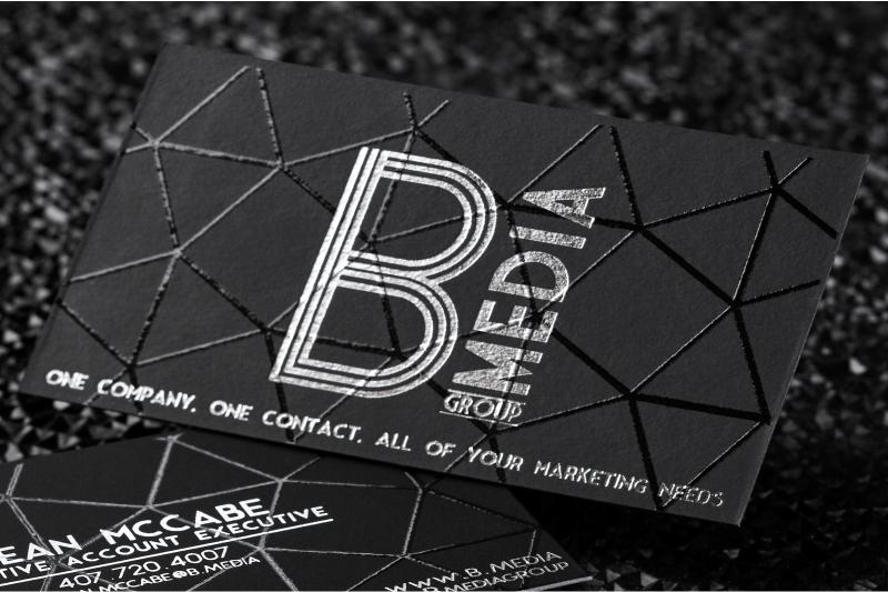 onyx suede business card with silver foil and spot uv