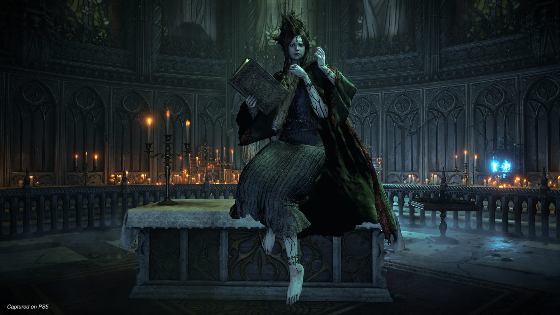 Demon's Souls image of a woman sitting in a church