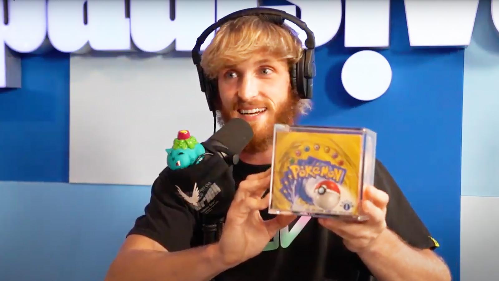 logan paul with pokemon card booster box