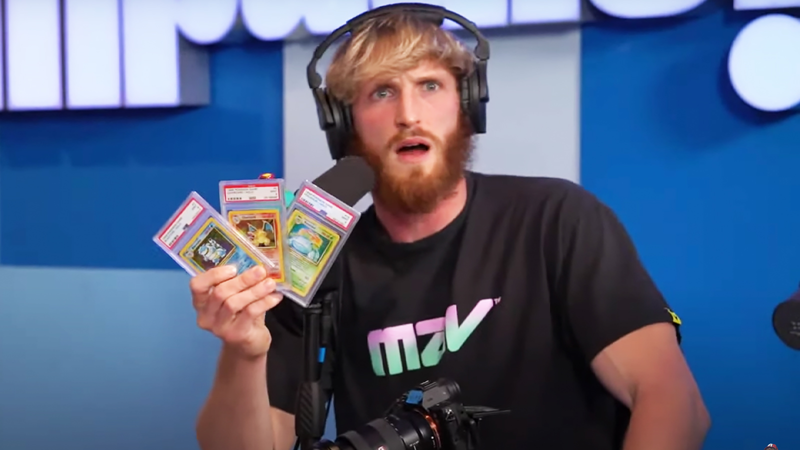 logan paul holding pokemon cards