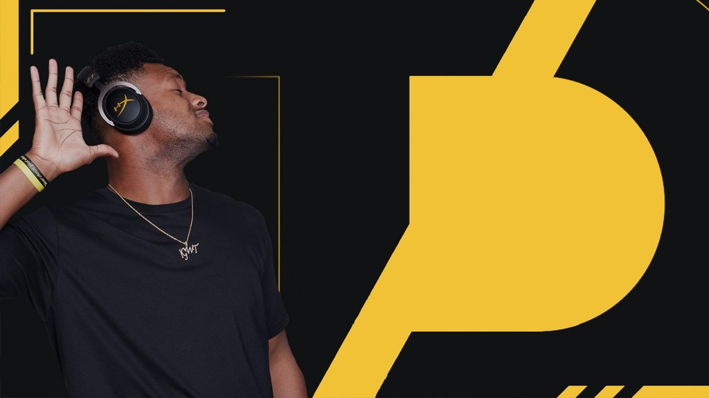 JuJu Smith-Schuster posing in front of Team Diverge logo.