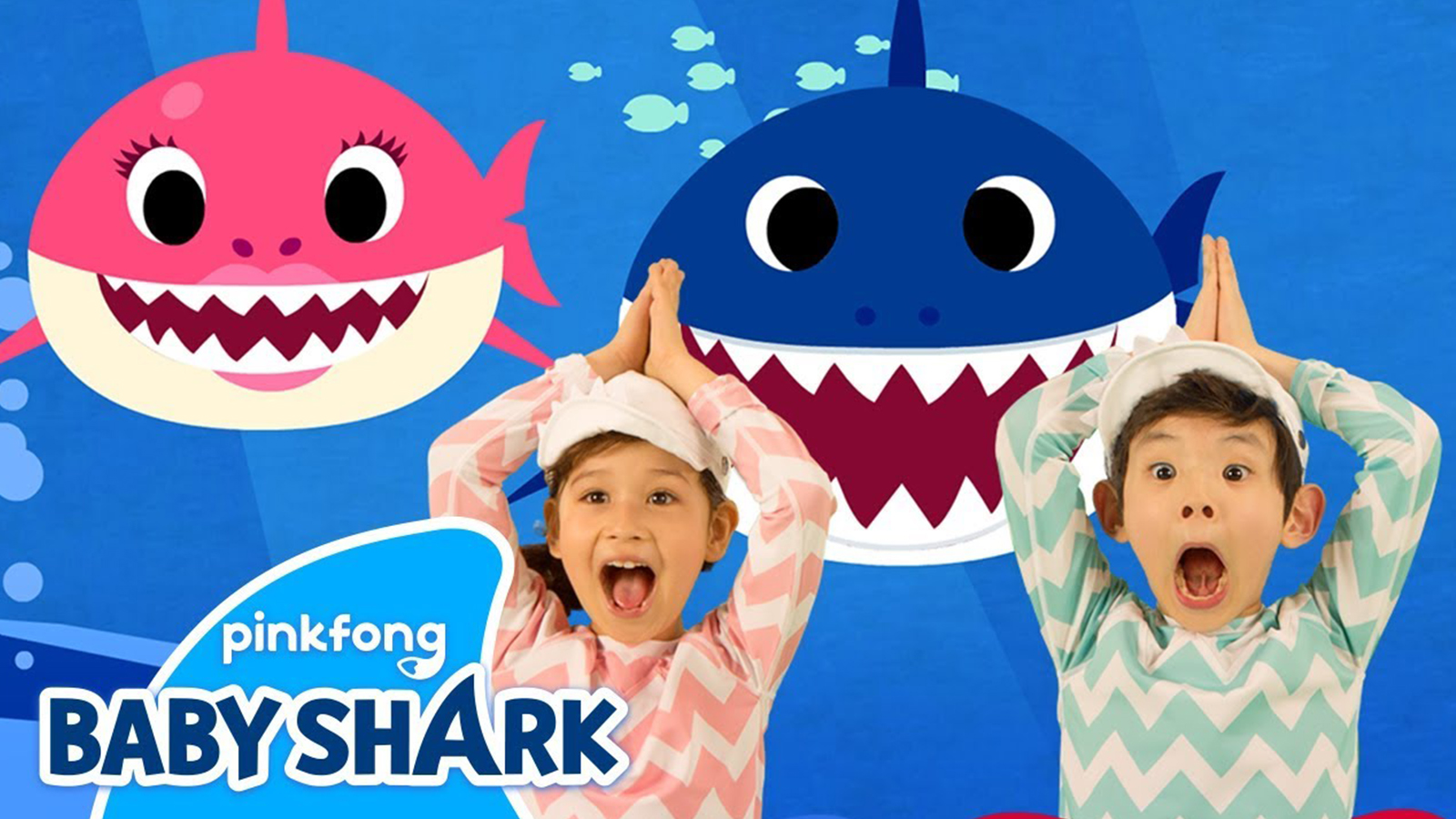 Two children dance to the Baby Shark song against an ocean background.