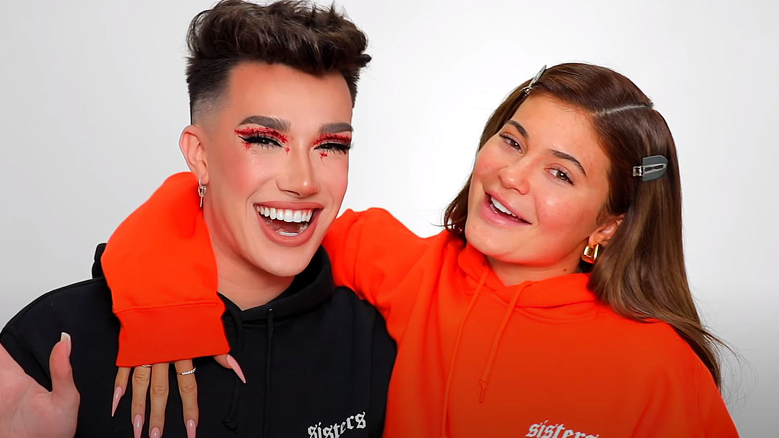 Kylie Jenner and James Charles hug during a YouTube video.