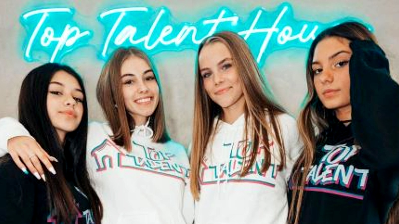Members of the Top Talent house pose by a sign