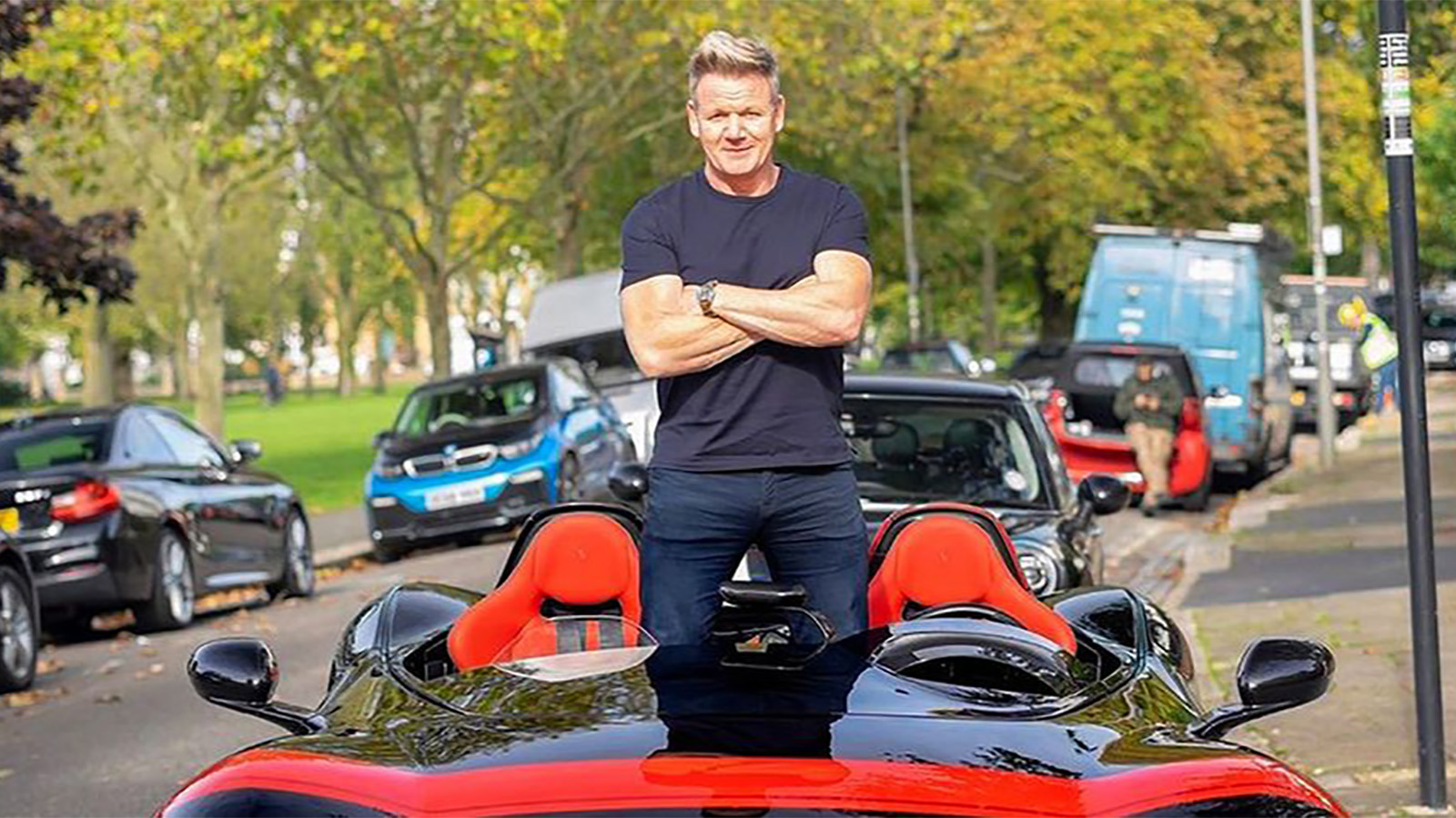 Gordon Ramsay standing in car