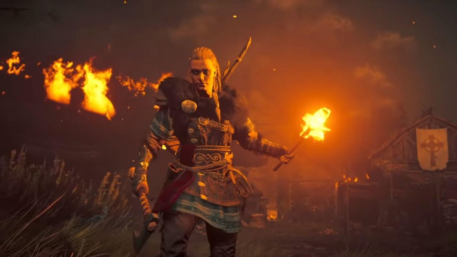 Eivor in a burning village in Assassin's Creed Valhalla