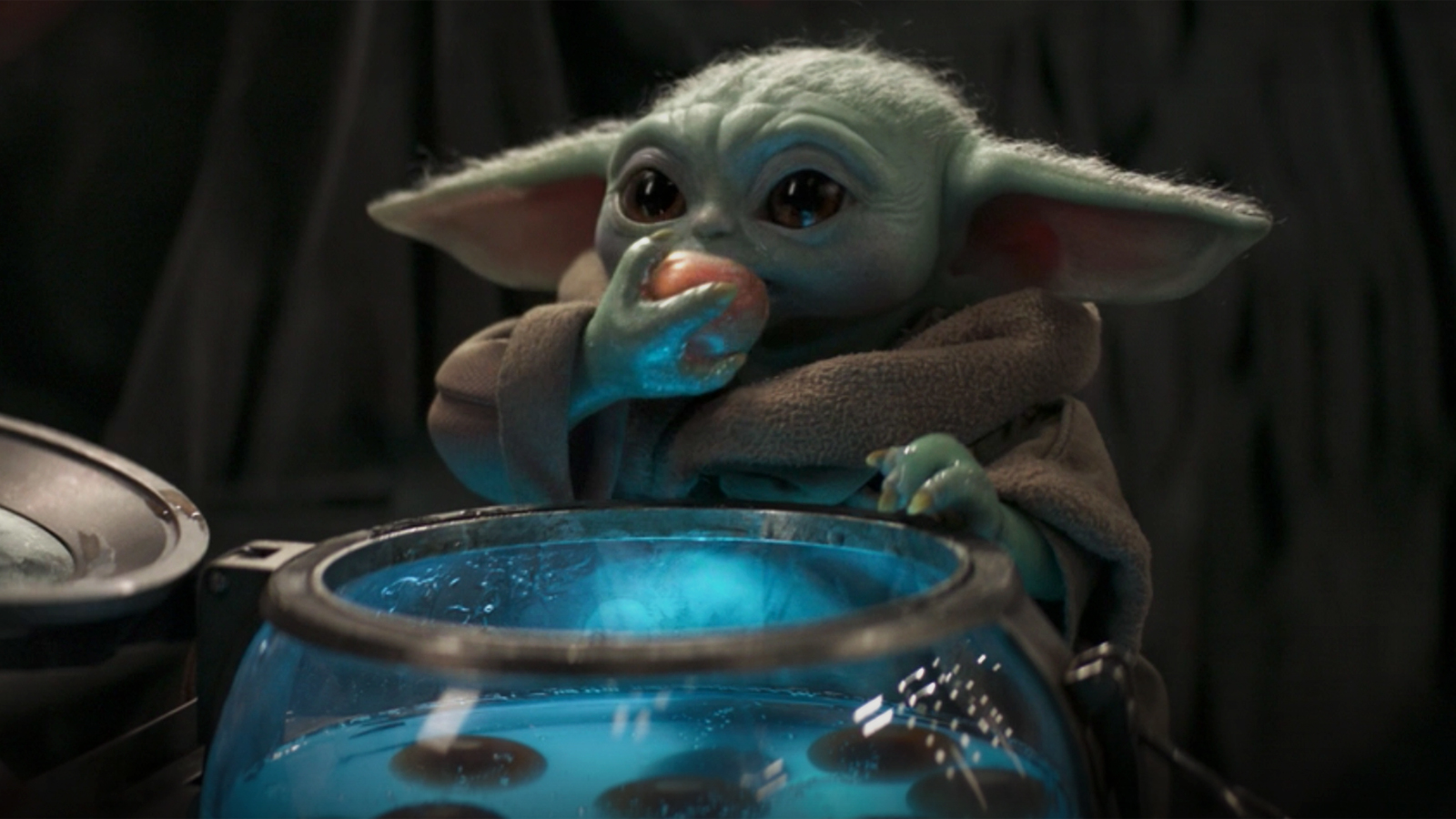 Baby Yoda eating eggs in The Mandalorian