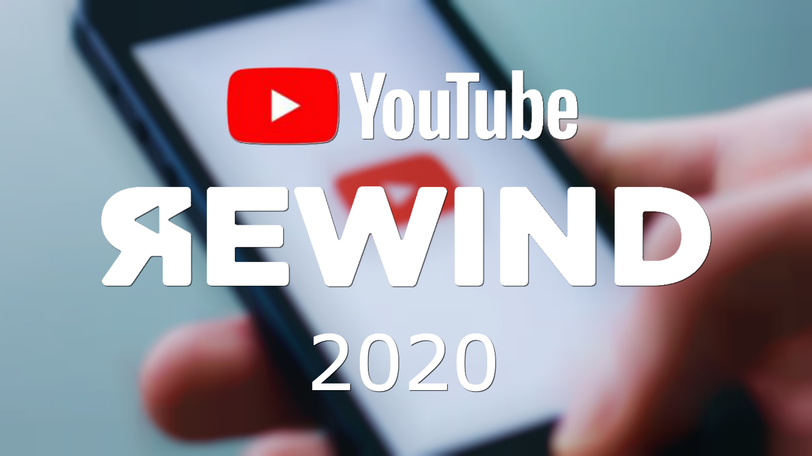 The YouTube Rewind logo is shown above a photo of the YouTube logo on a smart phone.