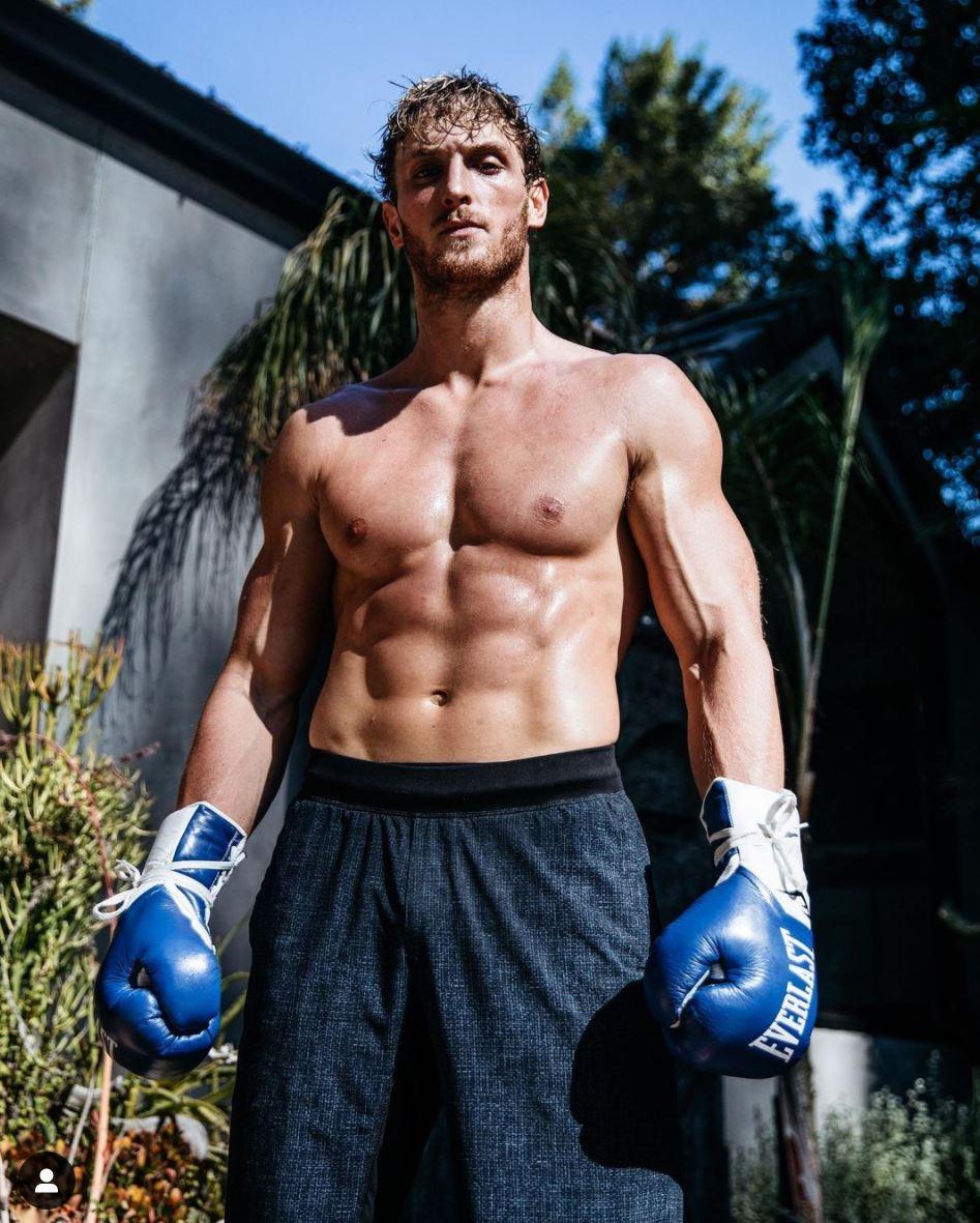 Logan Paul poses in boxing gear.