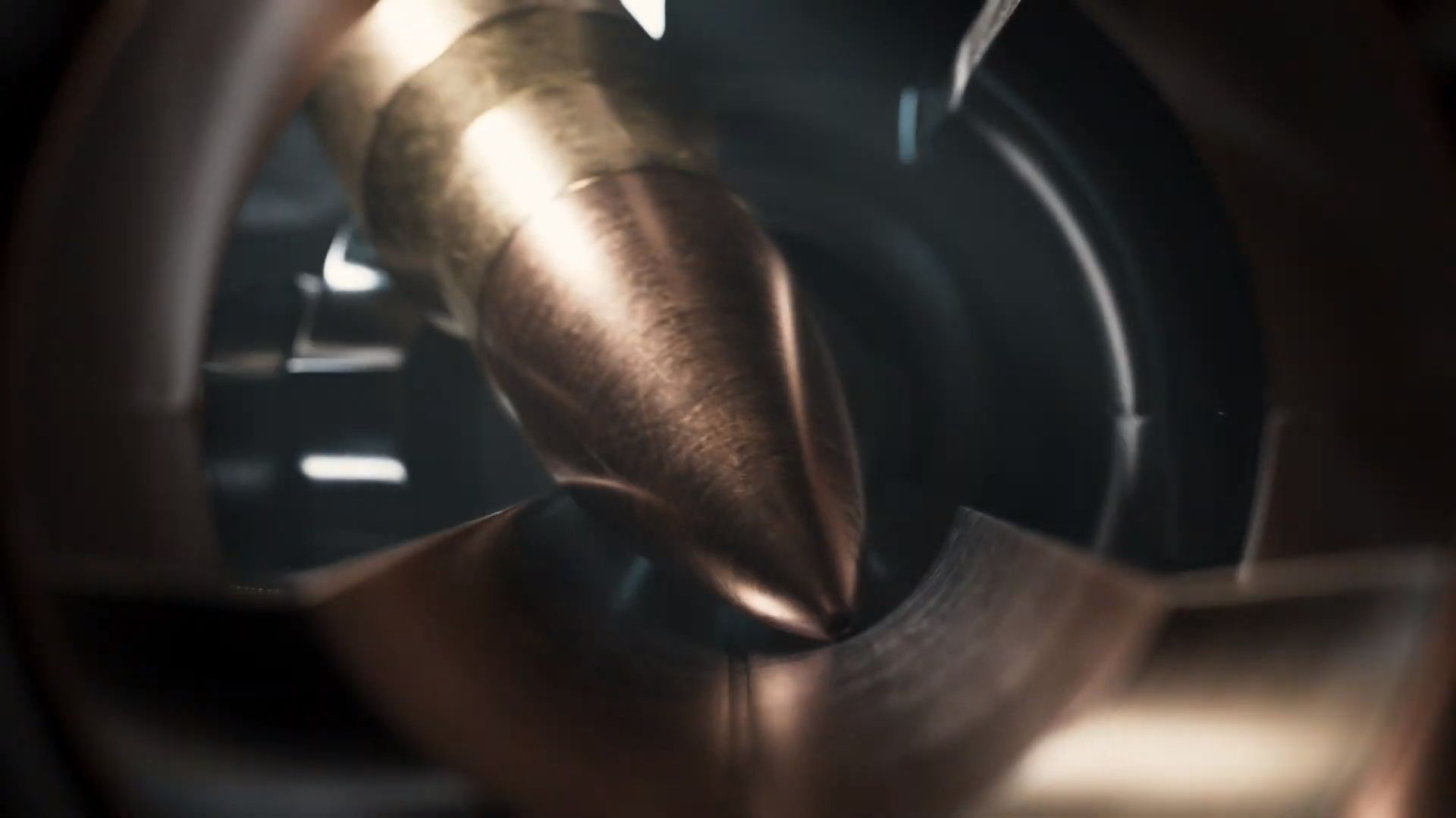 A rifle bullet being loaded in the Project 007 teaser.