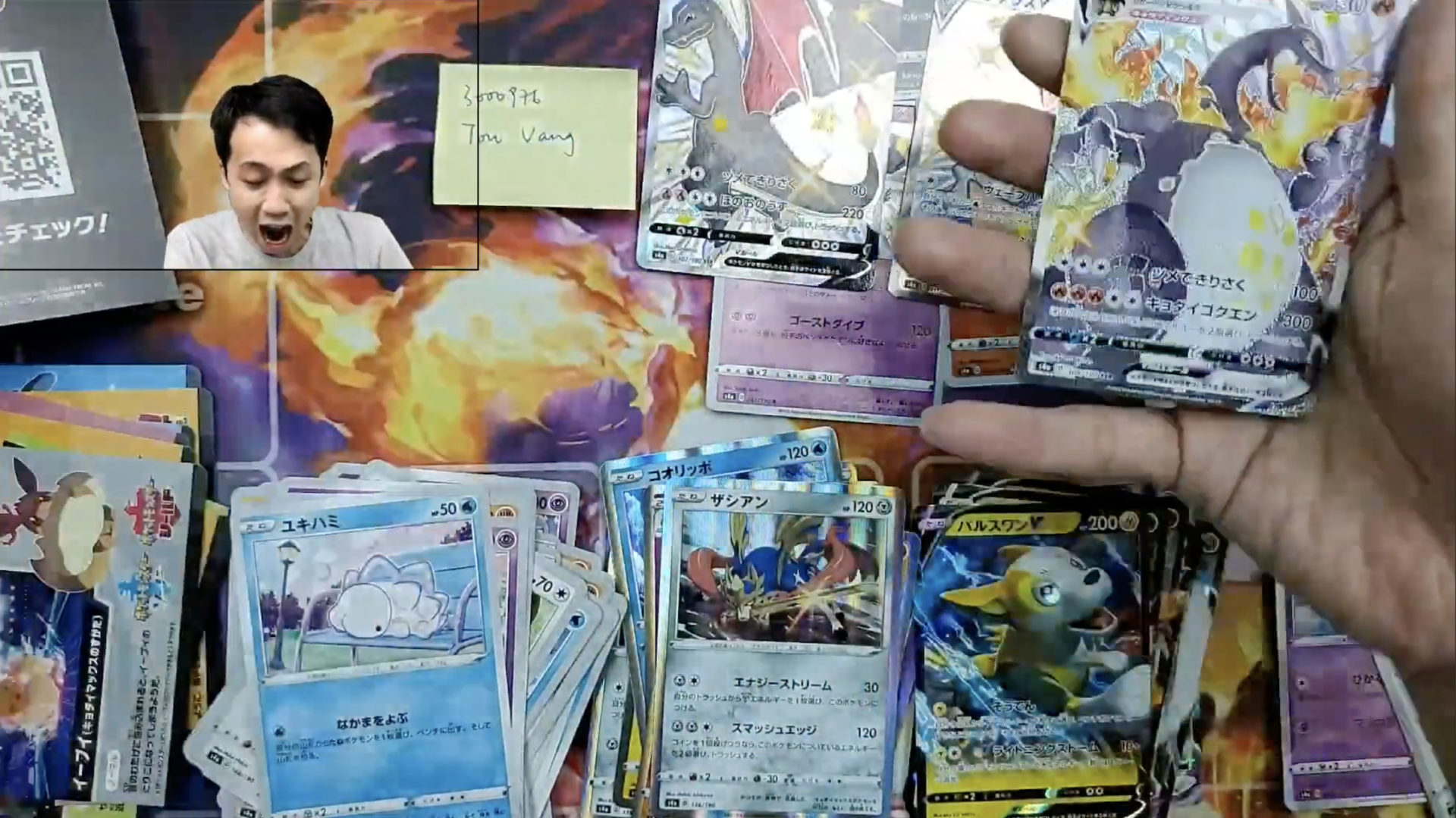 Pokemon YouTuber loses it after pulling a Charizard card.