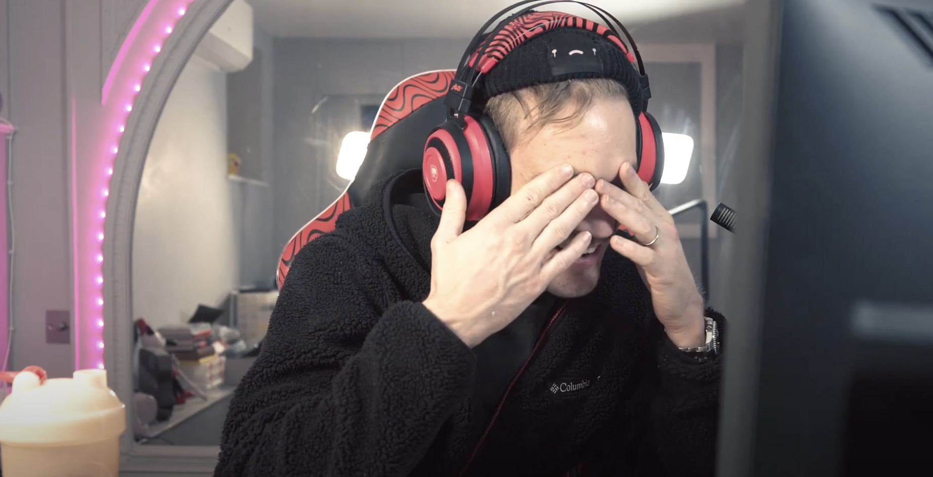 YouTuber PewDiePie with his hands over his face.
