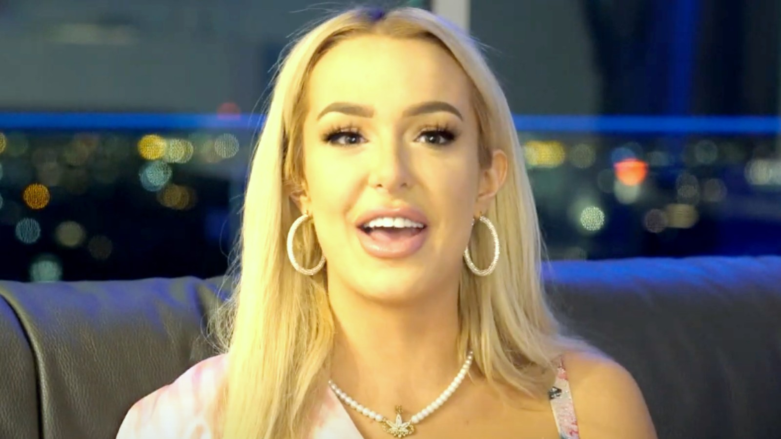 Tana Mongeau sits facing the camera in a storytime video