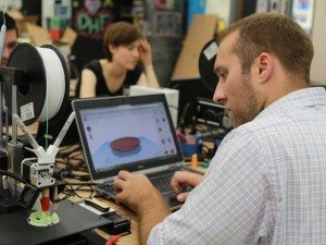 attendees working with 3D printers during Digital Harbor Foundation's 3D Printing for Educators workshop