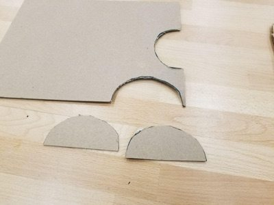 chipboard with half-circles cut out