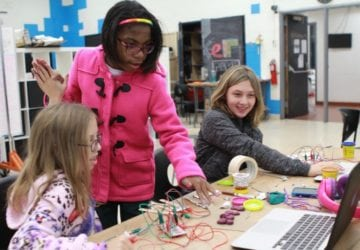 youth working with makey makey at a table