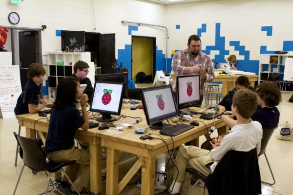 Raspberry Pi for Educators Facilitator working with youth at a Raspberry Pi station