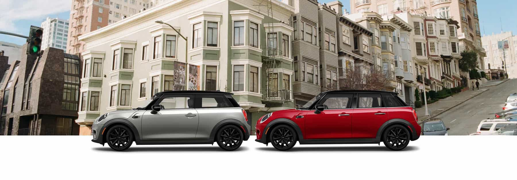 MINI Grey Oxford Edition MINI  Cooper 2 Door Hardtop and Red Oxford Edition MINI  Cooper 4 Door Hardtop in front of cityscape.