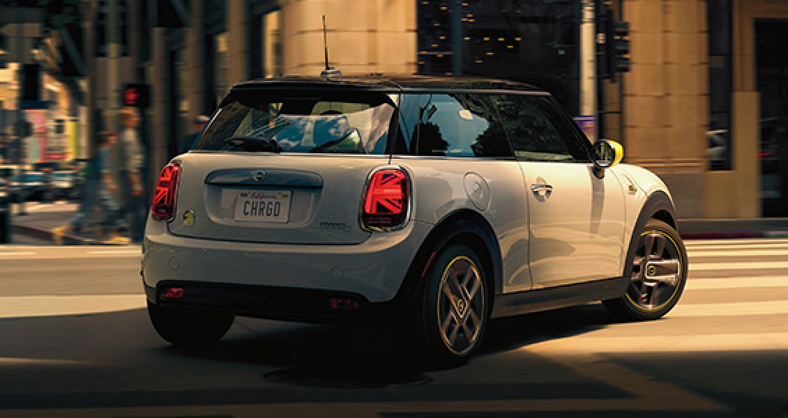 MINI Electric Hardtop 2 Door – white silver with yellow trim and black hardtop rear view