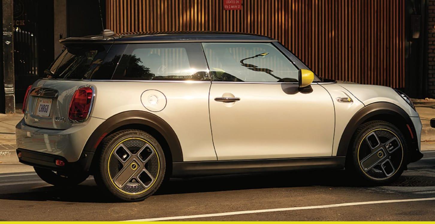 MINI Electric Hardtop 2 Door – white silver with yellow trim on street