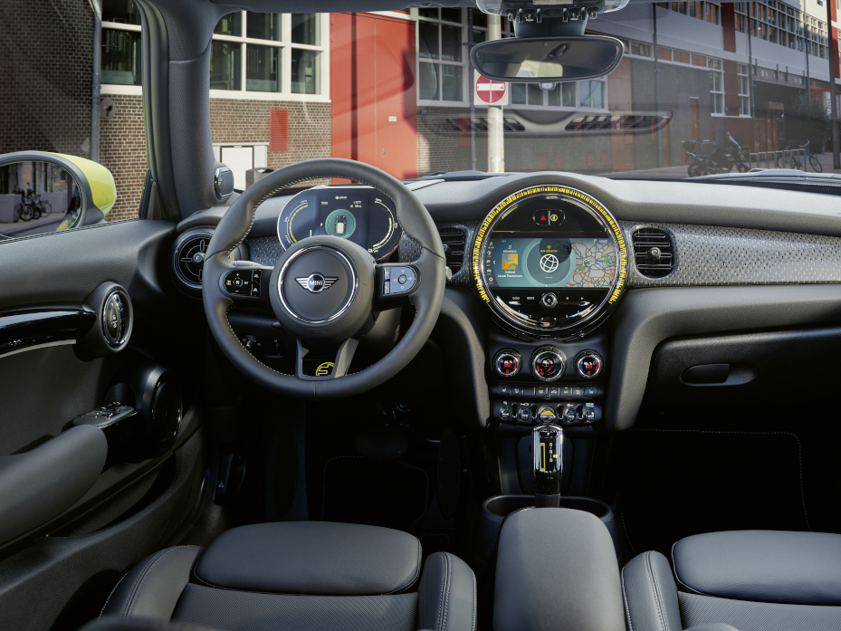 A view of the updated steering wheel, dashboard, and radio of the 2022 MINI Cooper SE Hardtop 2 Door.