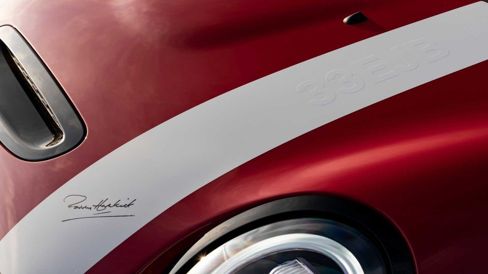 A close up of the white bonnet stripe embossed with the 33EJB number plate and Paddy Hopkirk signature.