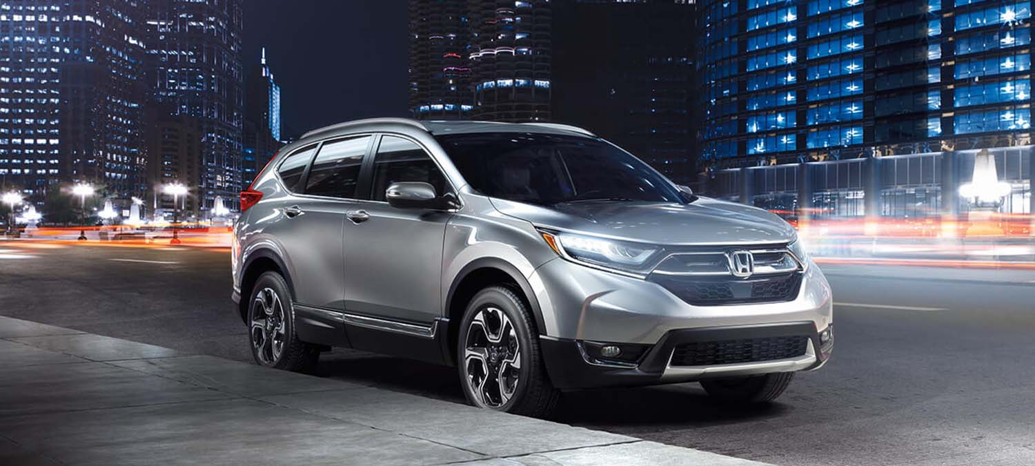 2019 Honda CR-V AWD Exterior Front Angle Passenger Side City Night