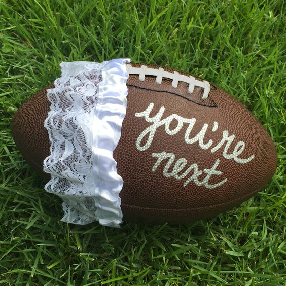 Football with a garter around it