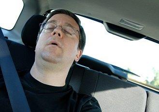 Man asleep in car automotive