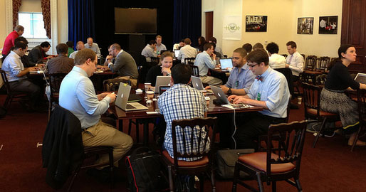 Photo of hackers working at the White House civic hackathon.