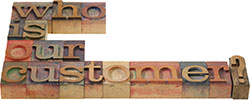 Who is our customer? spelled out on old-fashioned, wooden typography blocks