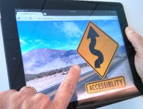 Image of an IPad with an accessibility sign on it.
