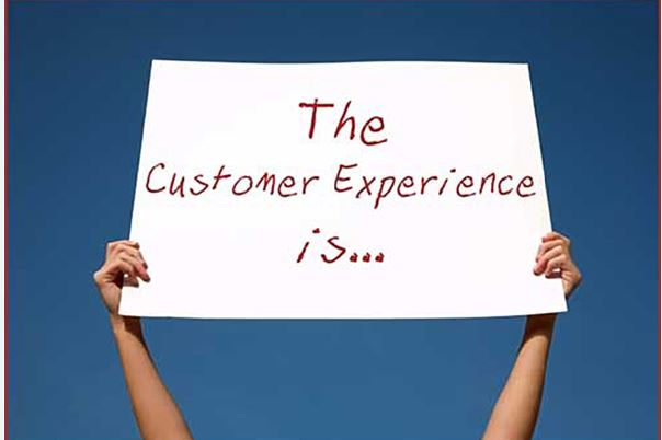 arms holding a sign that says the customer experience is...