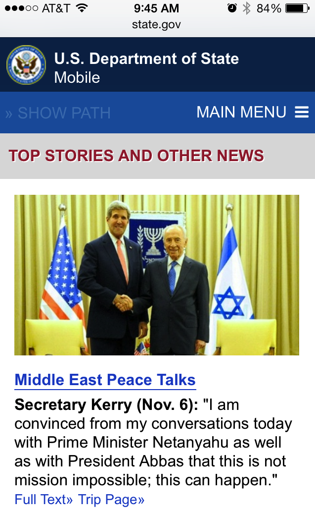 Smartphone screen shot showing the home page of the Department of State's mobile site with Top Stories and Other news. It shows a photo of Secretary Kerry and the prime minister of Israel, then the first paragraph of the story below it.